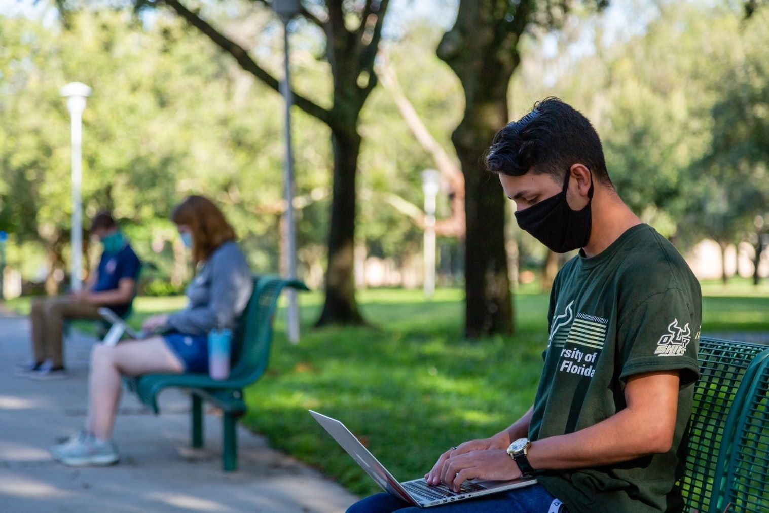 USF student with mask on campus
