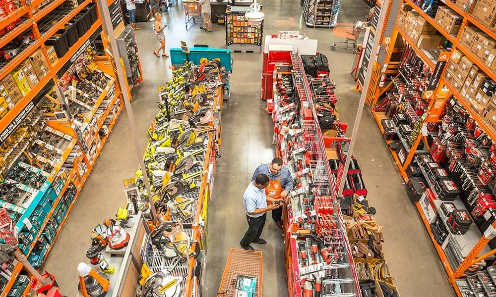 Customers talk to associate in Home Depot