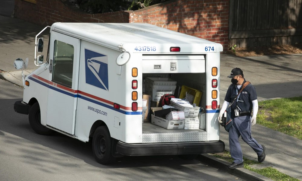 USPS delivery man with the truck