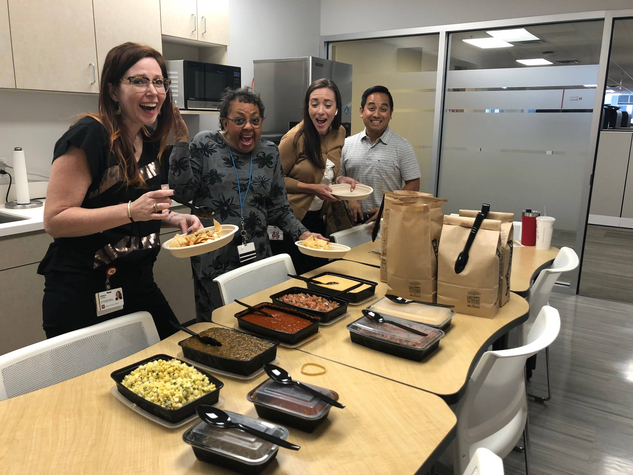 Staff enjoy Chipotle catering in the office