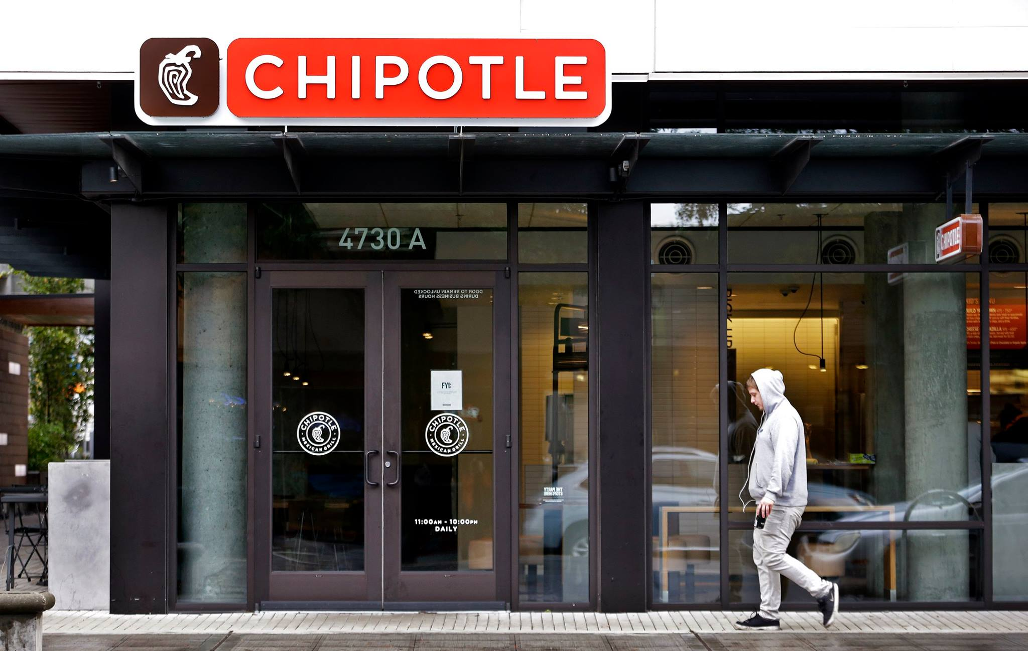 Customer walk by Chipotle store