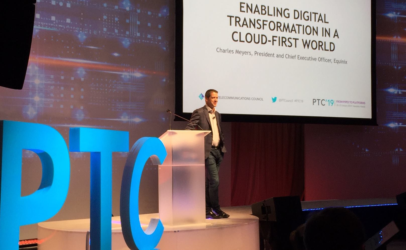 Equinix CEO Charles Meyers give talk on stage