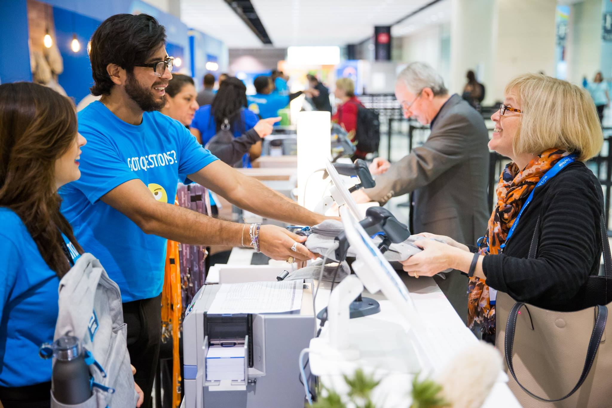 Staff at register station at Workday conference event