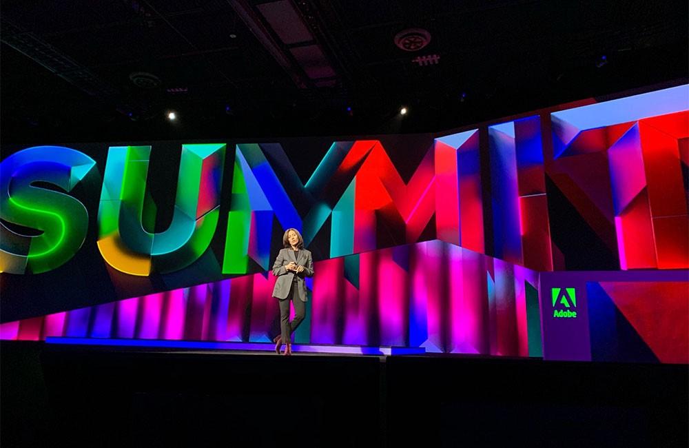 Adobe staff talks on stage at Summit event