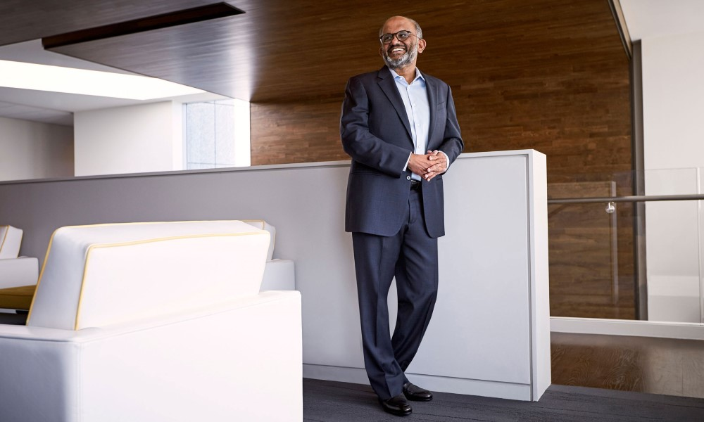 Adobe CEO stands in the office hall