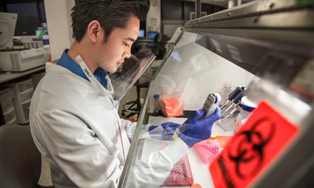 Quest Diagnostics staff in a lab and test