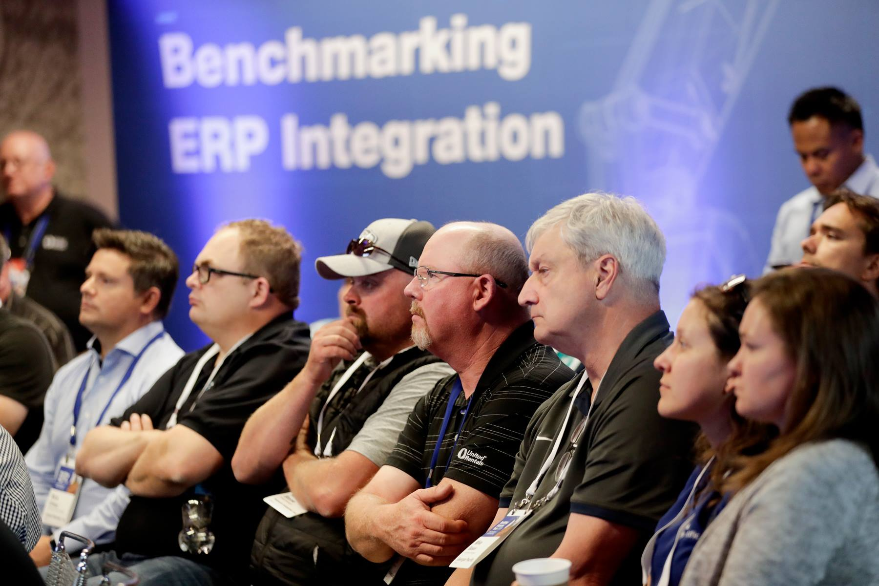 people attend conference at United Rentals ERP software