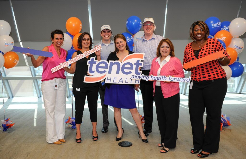 Tenet staff in a conference of moving health forward