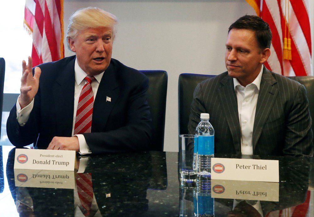 Palantir founder Peter Thiel at a meeting with Donald Trump