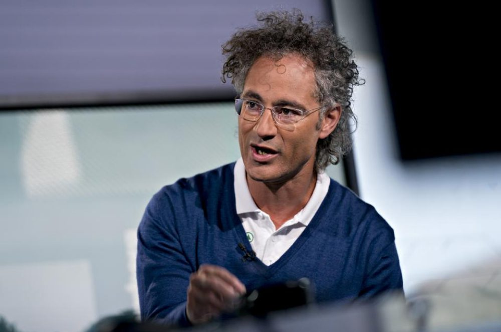Palantir CEO Alex Karp on stage at a conference