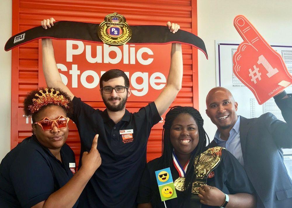 Public Storage staff with award
