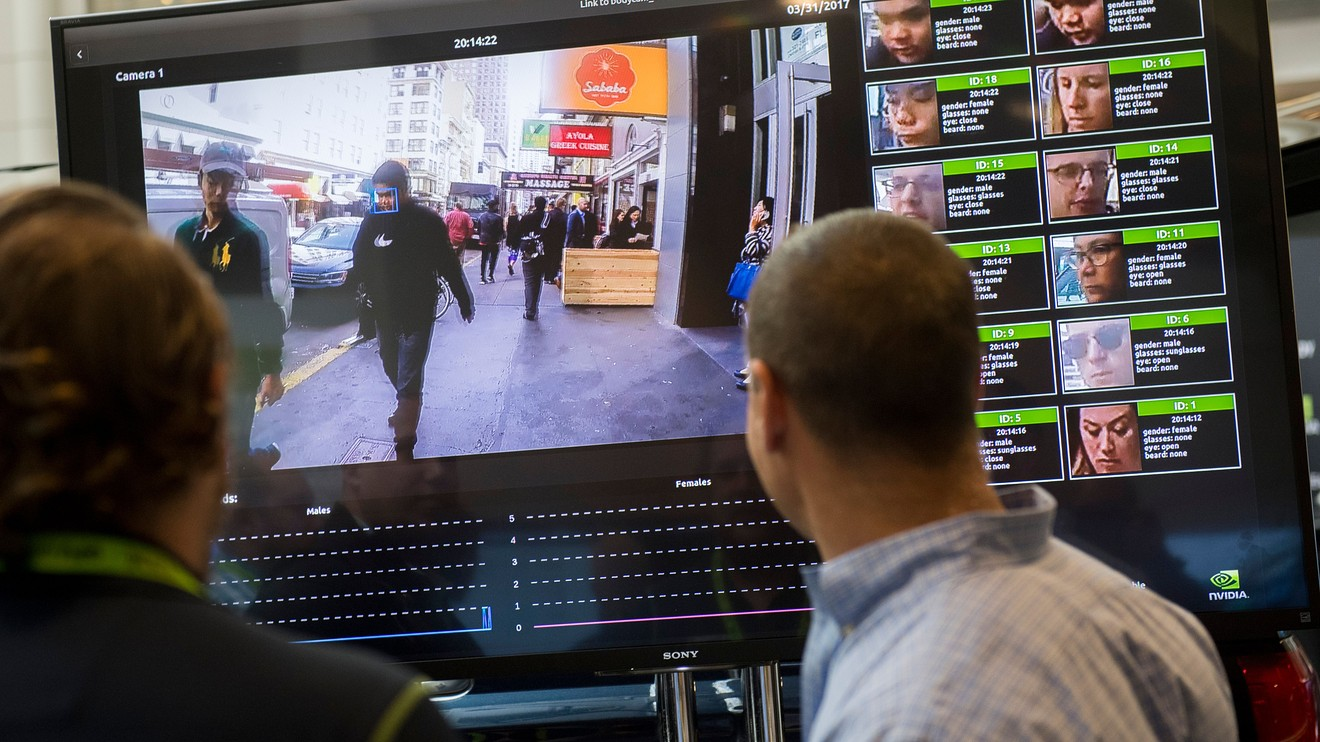 A man watch the video monitoring in face recognition