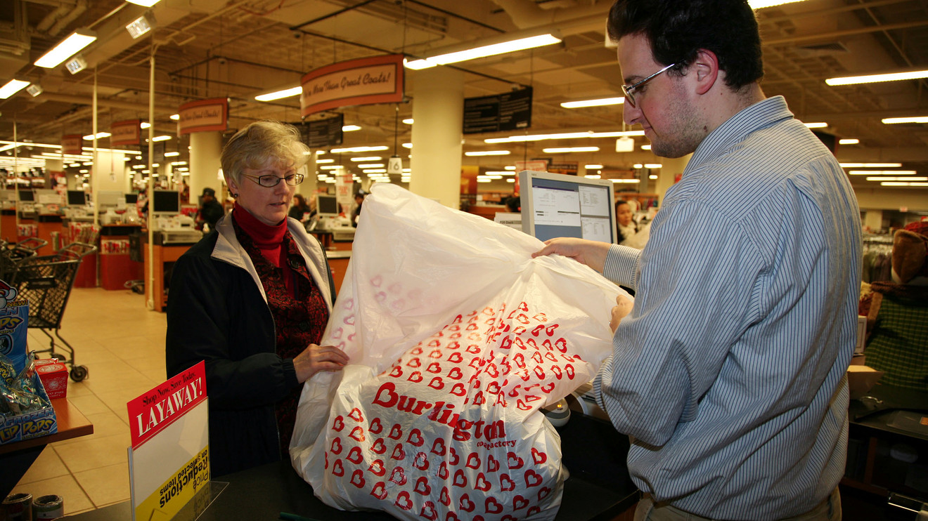 Customers check out at registration at Burlington store