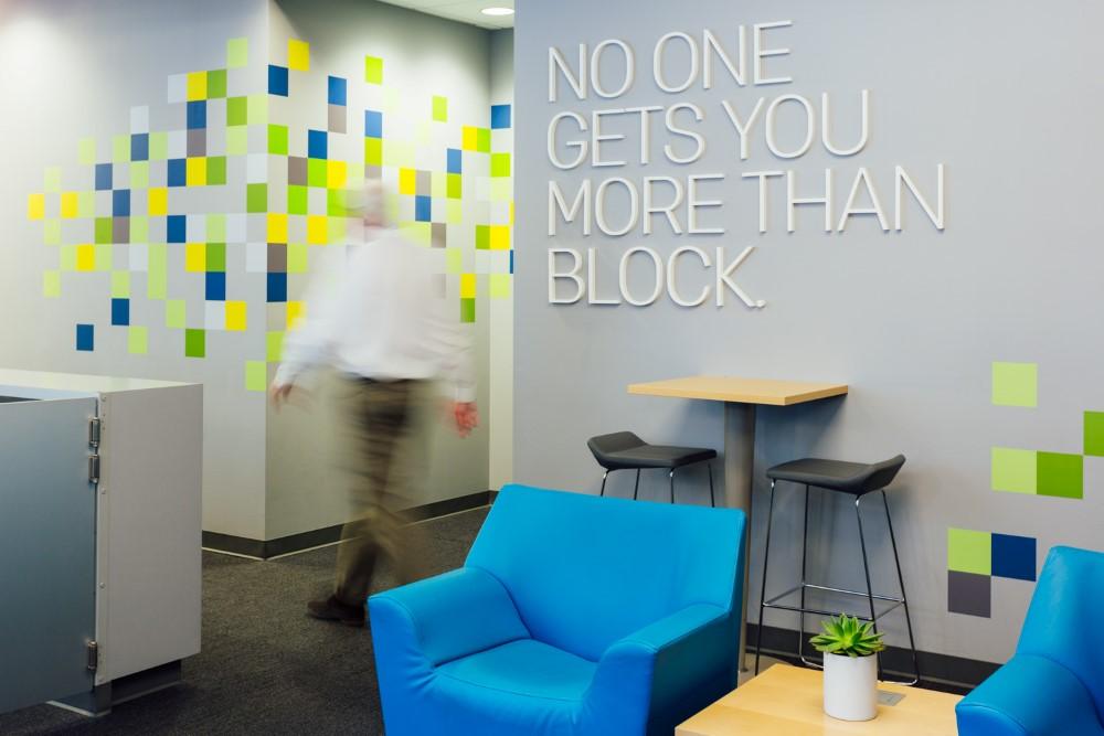 HR Block staff walk in a branch
