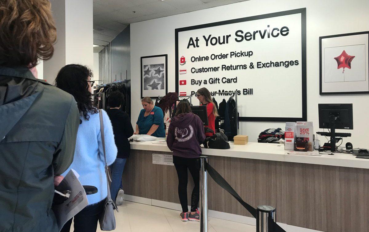 Macys customers wait in line to pickup online oreders