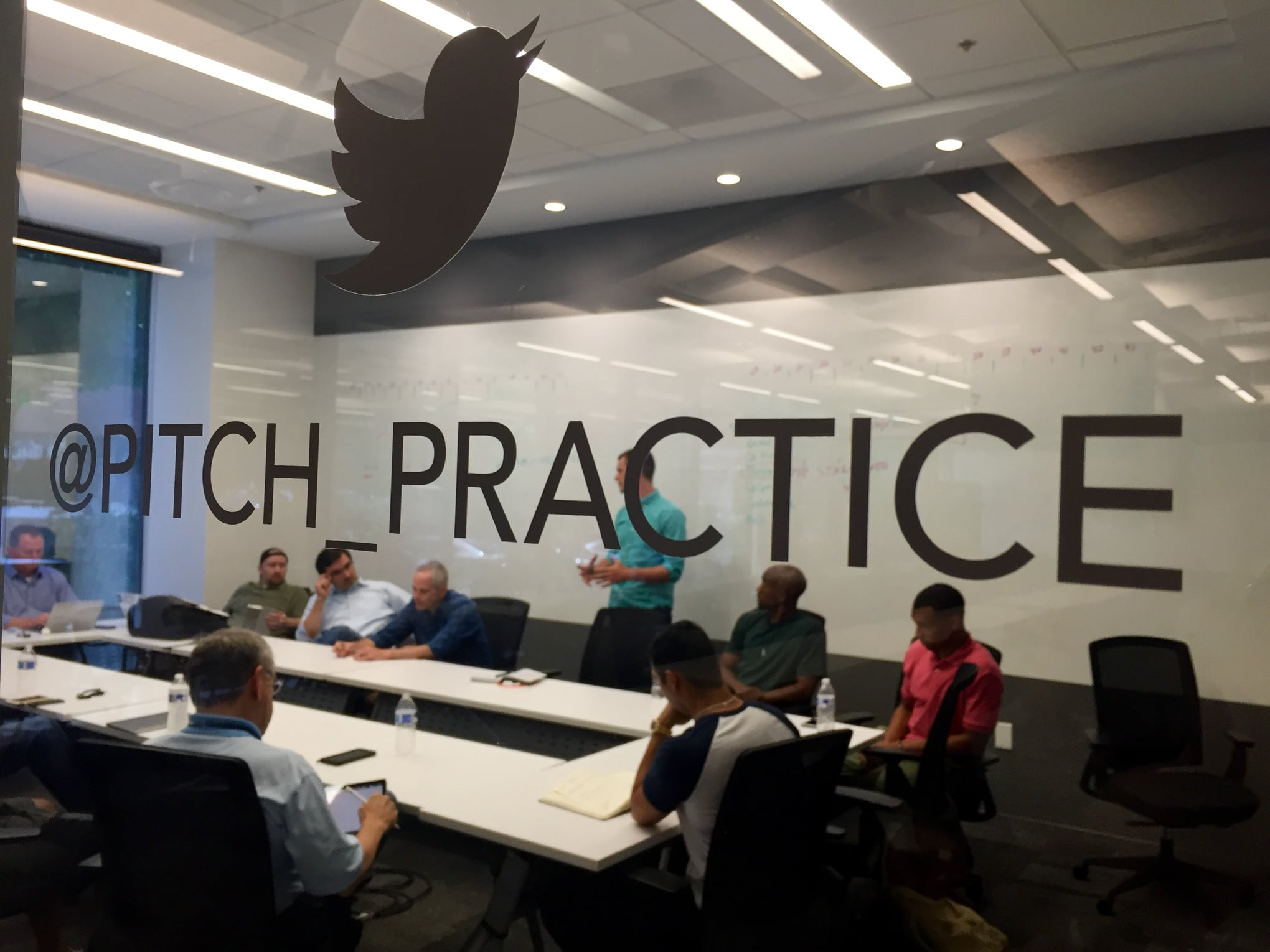 Startup founders practice pitch