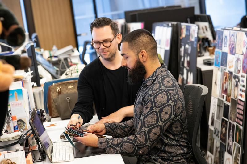 Coach designer team collaborate on project