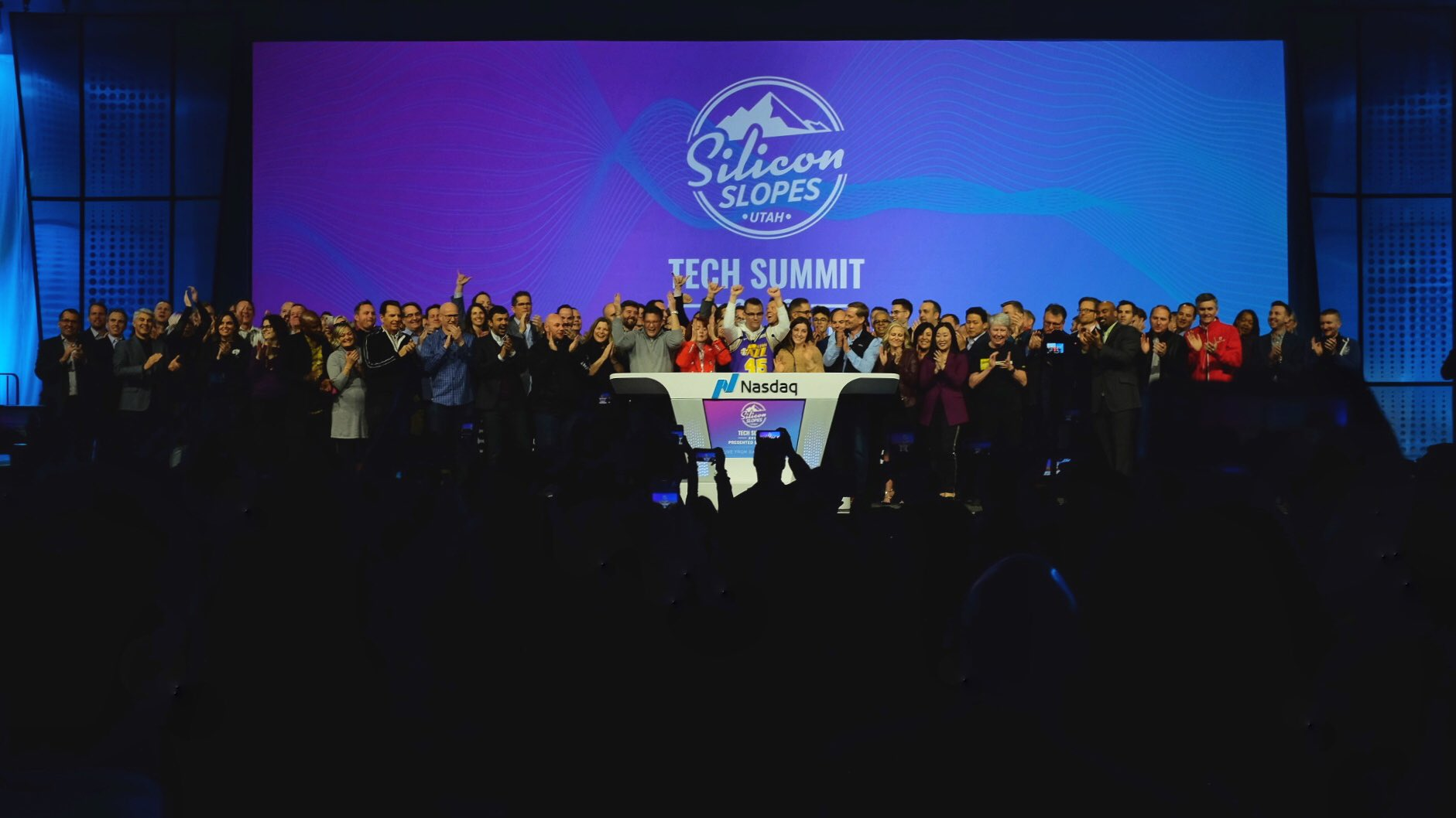 tech companies celebrate on stage at Silicon slopes tech summit