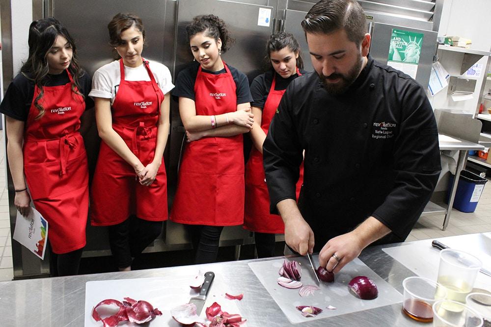 Revolution staffs in training in the kitchen