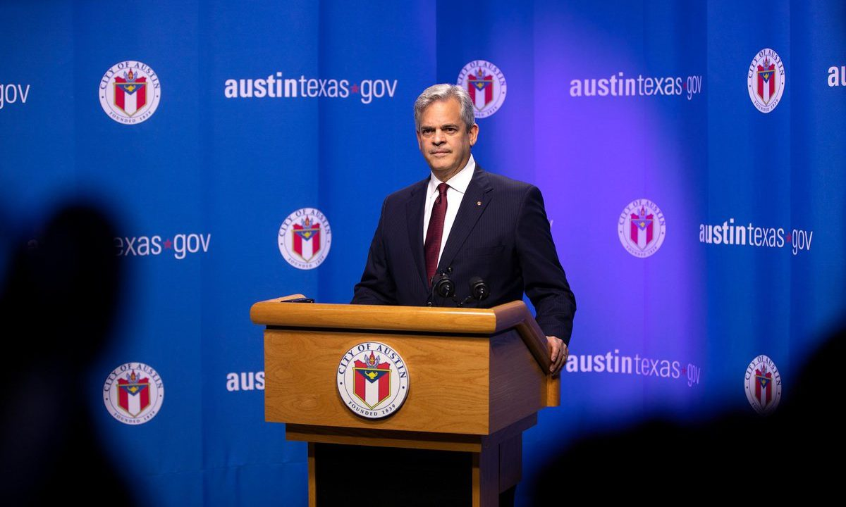 Austin mayor in a conference