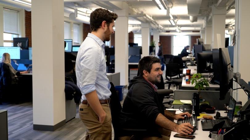 Tech staff collaborate on projecct