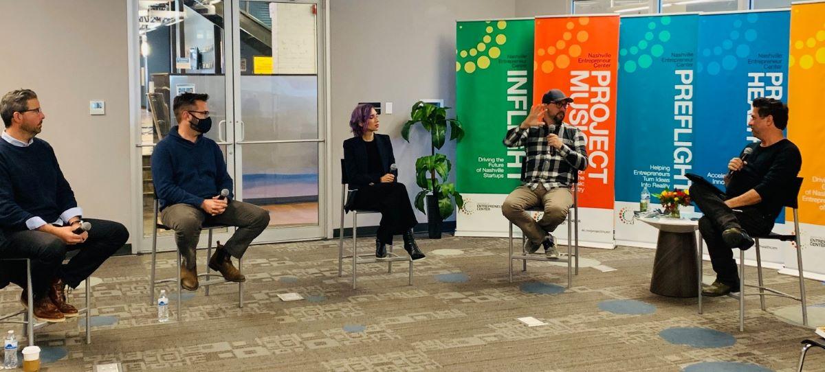 art entrepreneurs collaborate and discuss at NEC