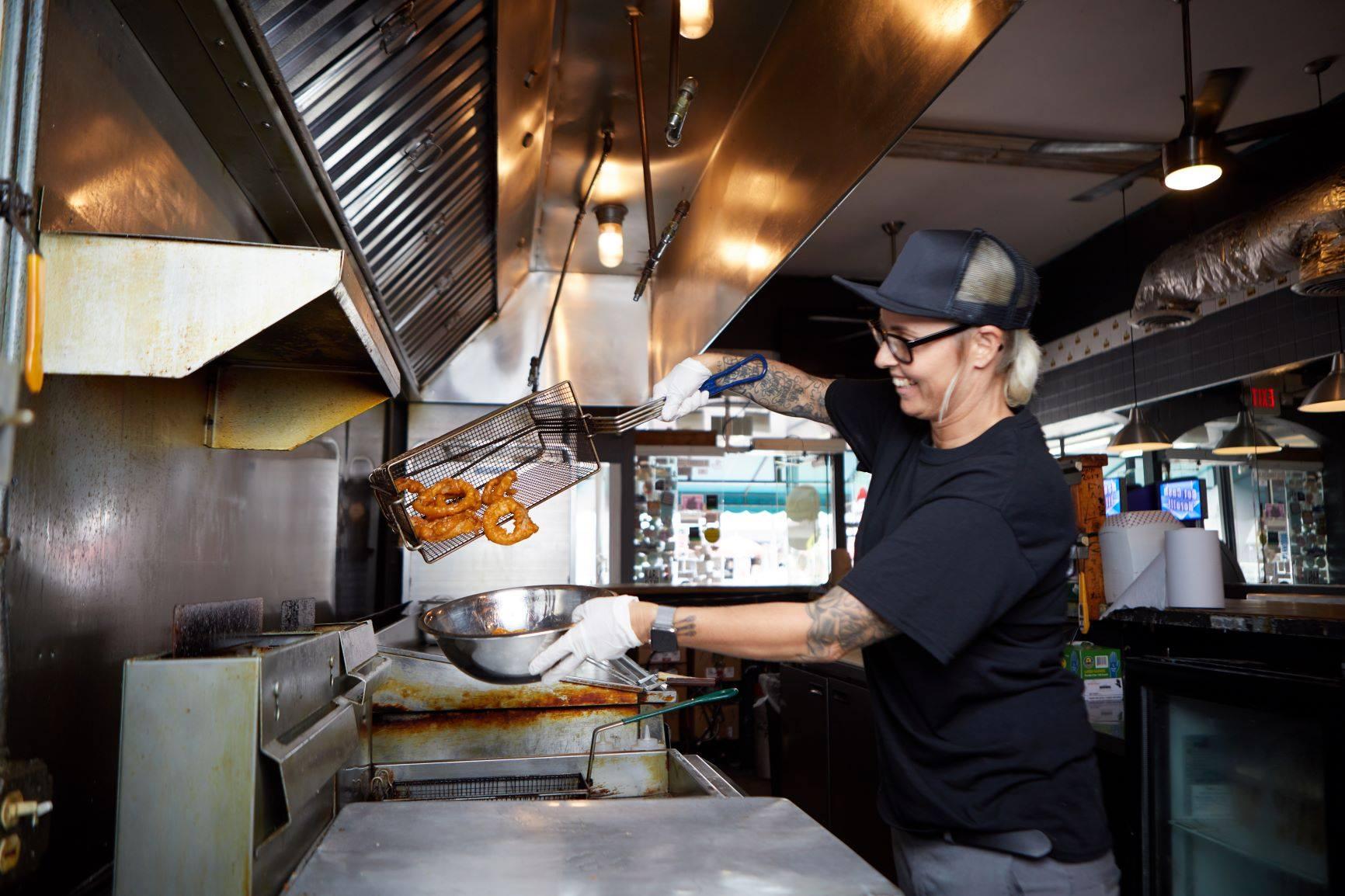 restaurant owner work in the kitchen