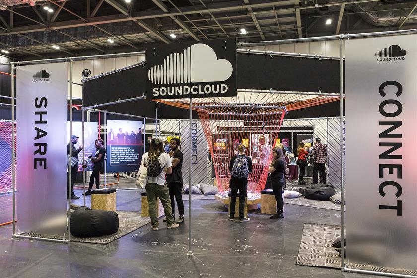 people network at SoundCloud booth in a conference