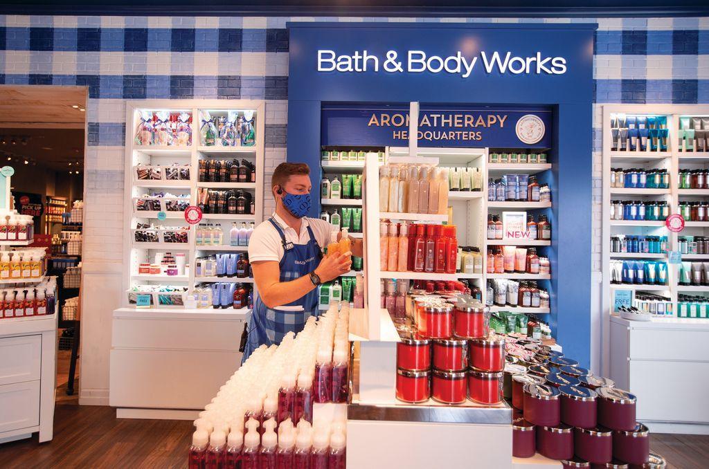 a male staff restock in Bath & Body Works store