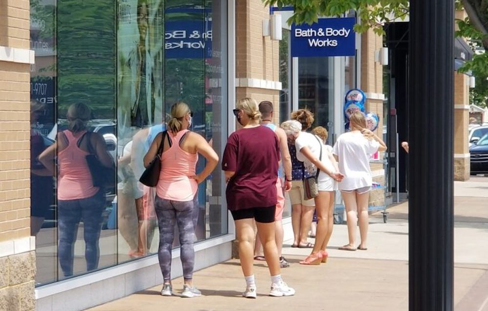 customers are wating in line at Bath & Body Works