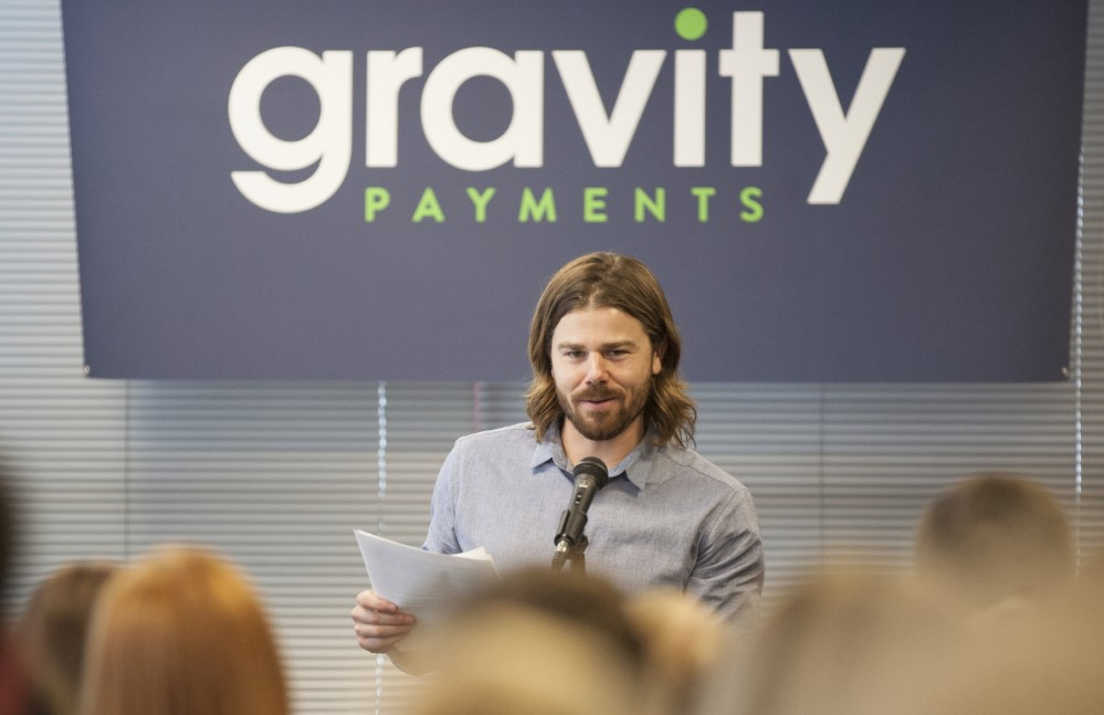 Dan Price in a meeting with company staff