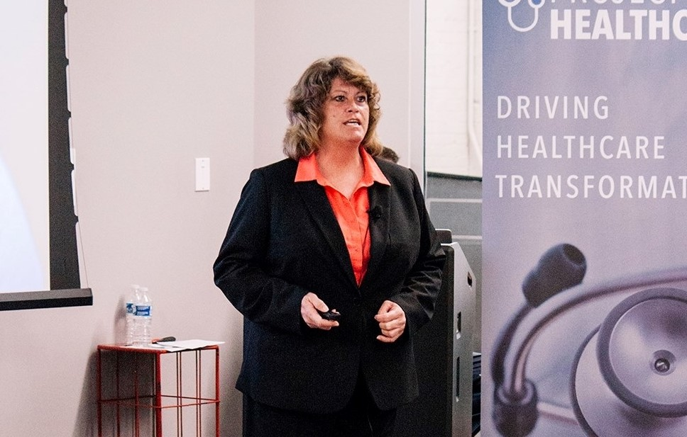 Female entrepreneur pitch in an event with her healthcare project