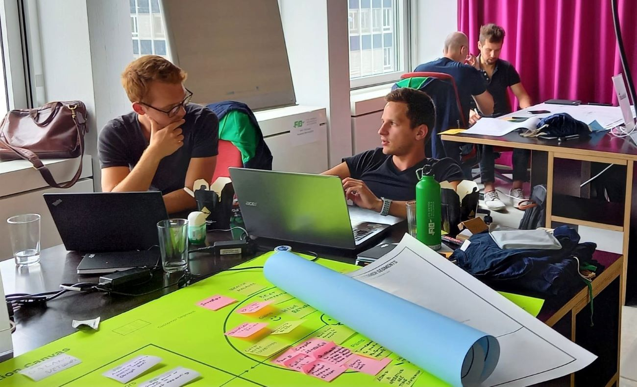 two young men collaborate on product roadmap