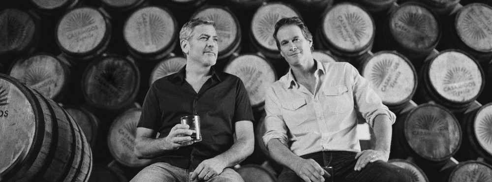 Casamigos co-founders at a liquor manufacture plant