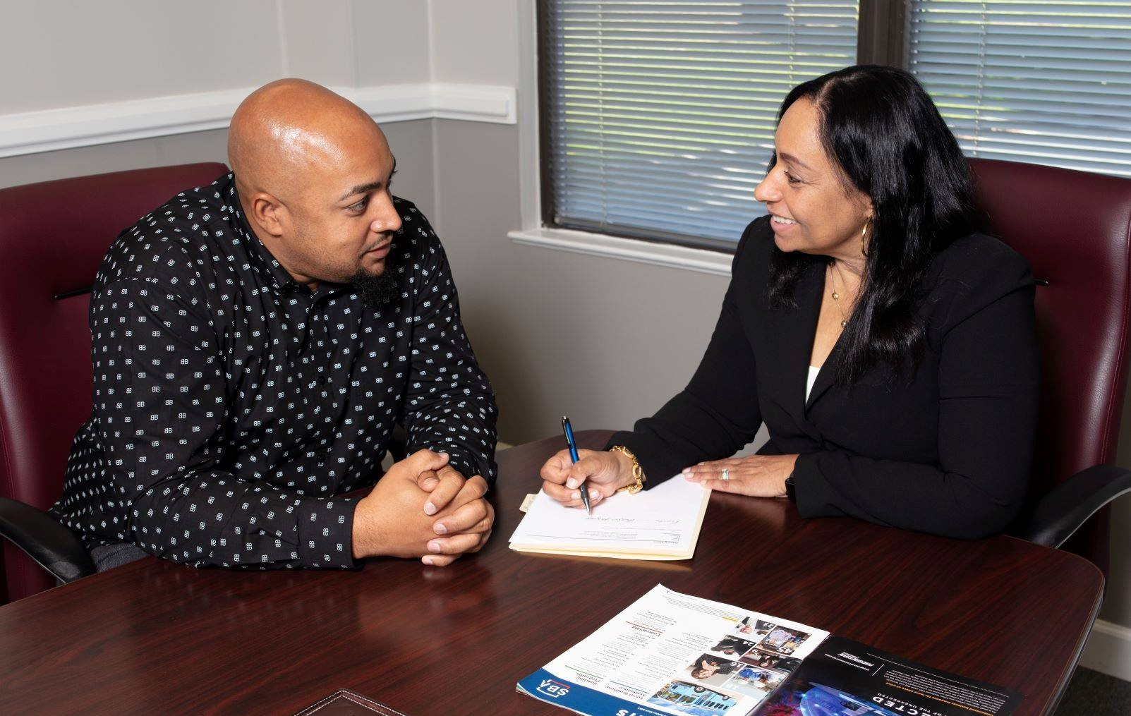 SBA staff collaborate with small business owners