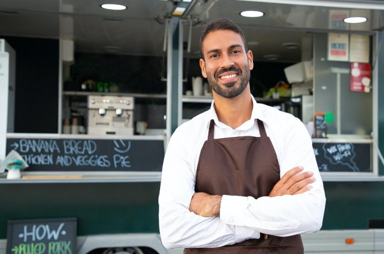 small business owner in front of a food truck