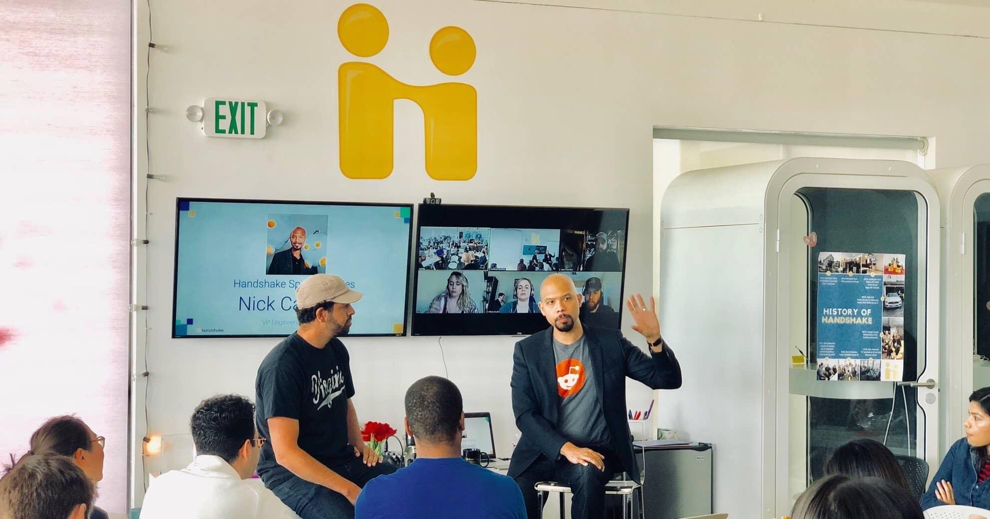 Handshake staff speak at a meetup event