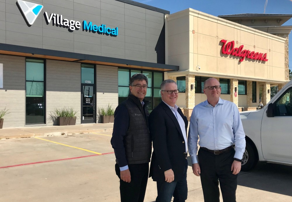 VillageMD leadership in front of the Walgreen and their clinic office