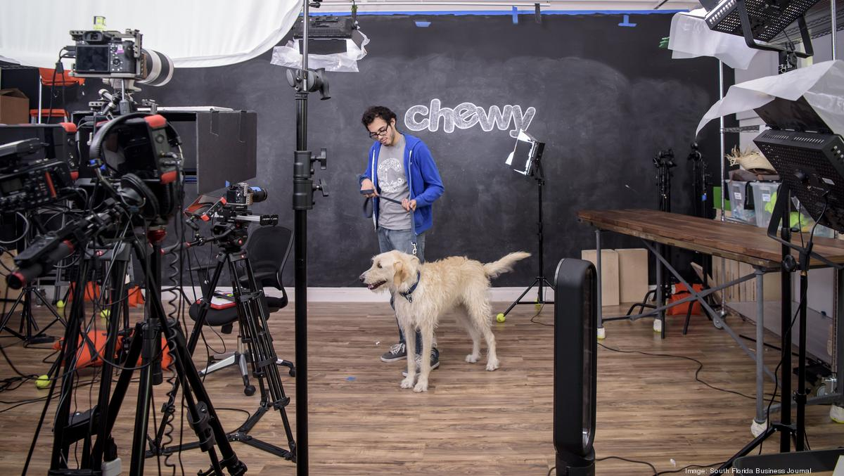 Chewy staff with pet in a photoshoot