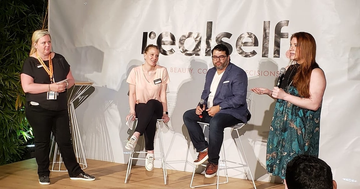 RealSelf staff shares stories in a conference