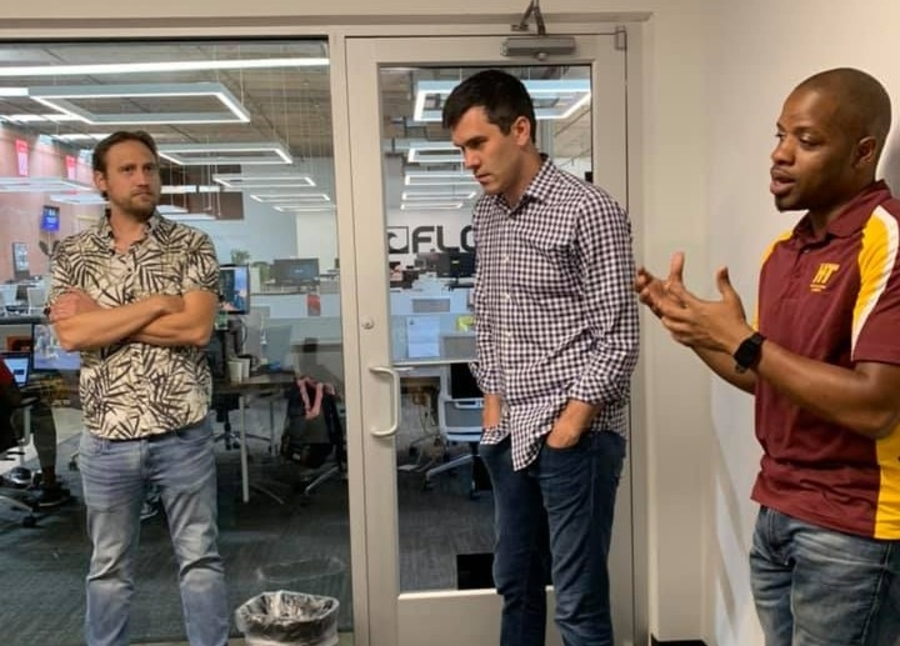 FloSports CEO and Co-founder collaborate with staff