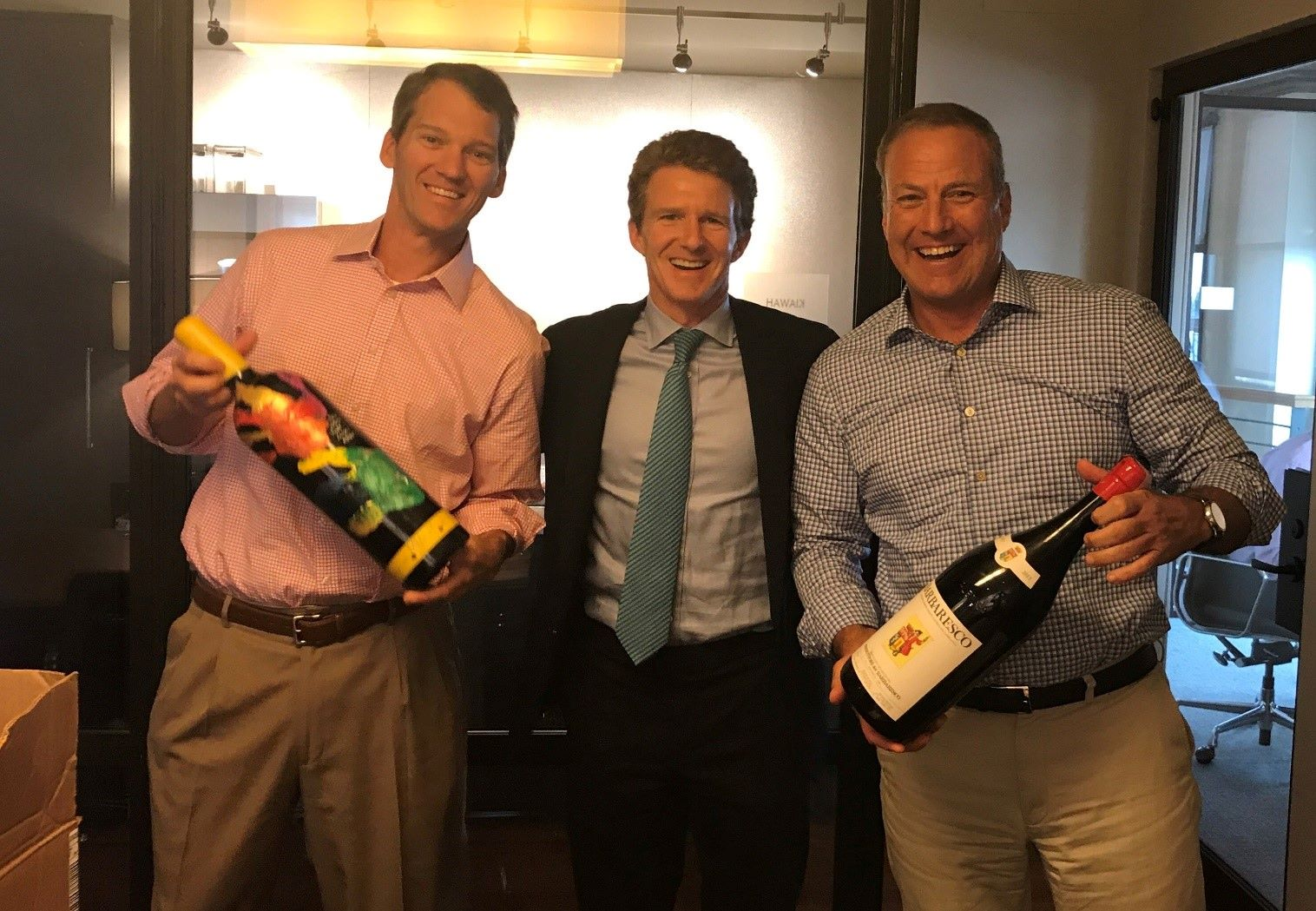 Greystar leadership team celebrate at the office