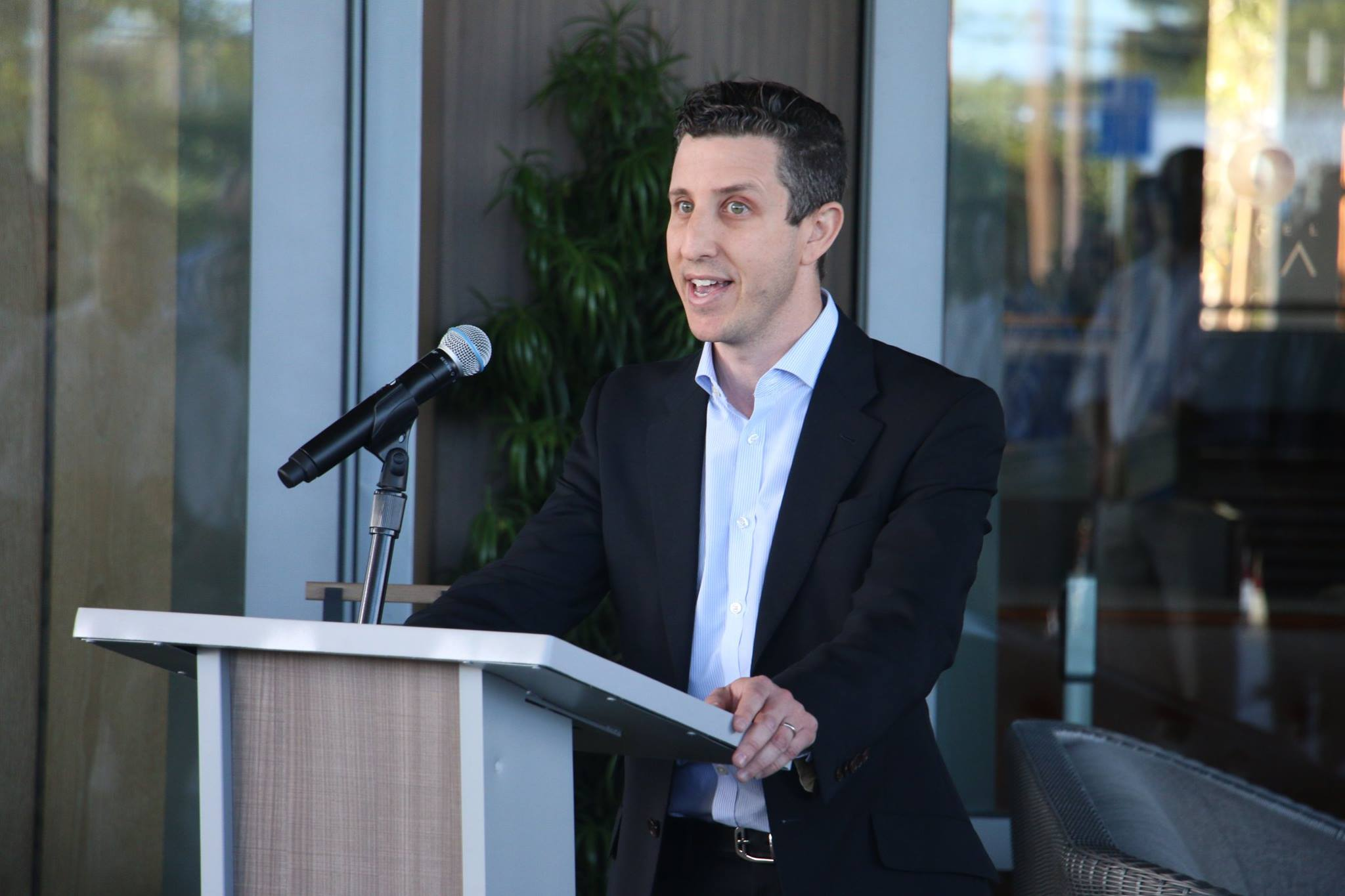 AECOM chief of capital speak at a hotel ribbon cutting event