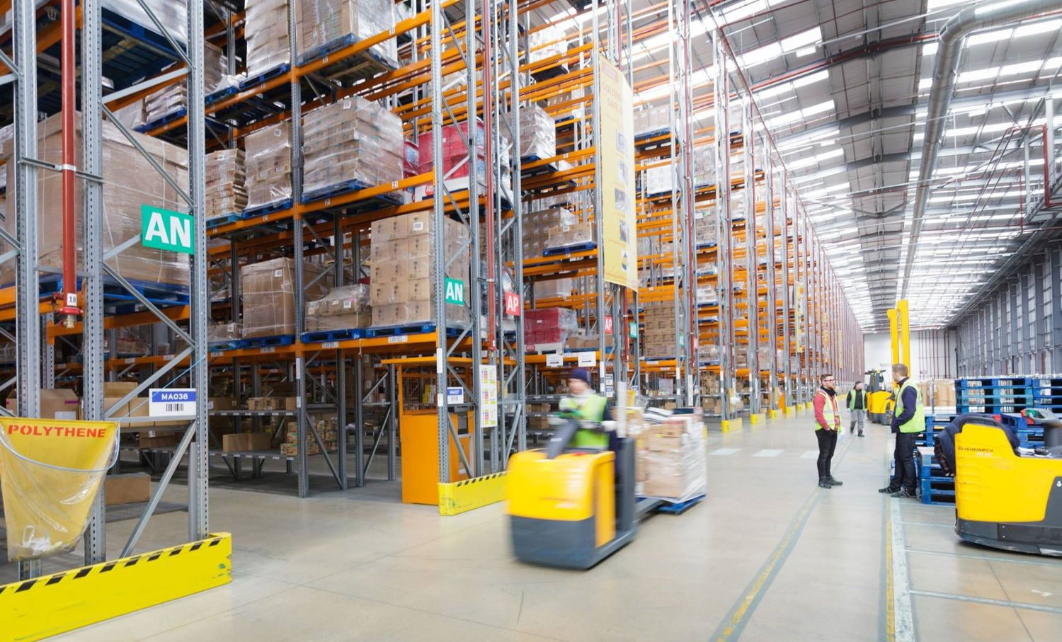 Frontline workers in warehouse use app to manage inventory