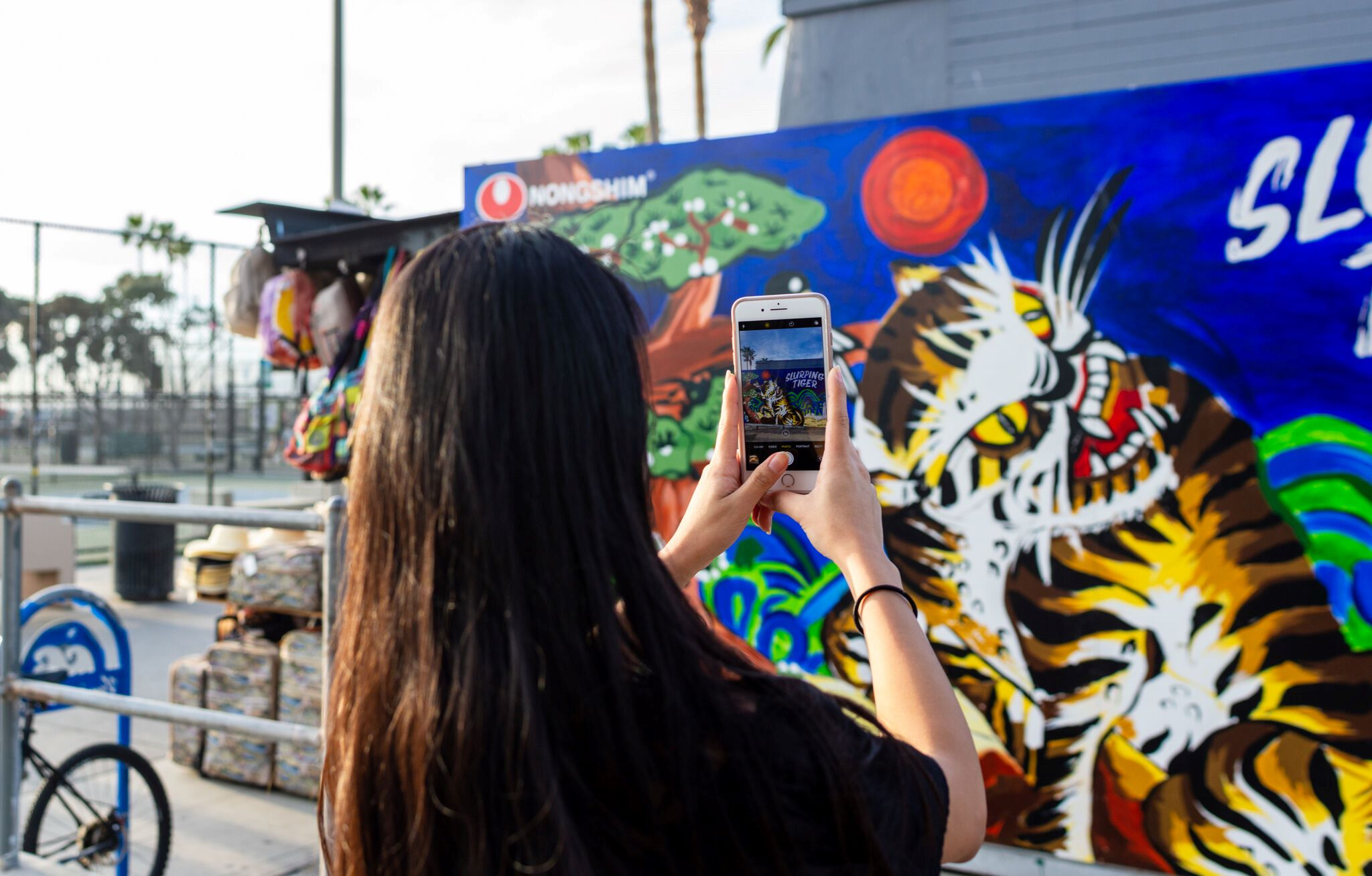 Young people take picture at Nongshim graffity drawing