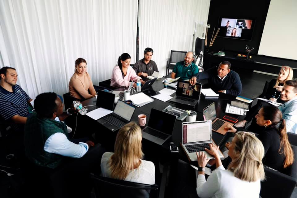 Alex Rodriguez in a meeting with team at A-Rod Corp