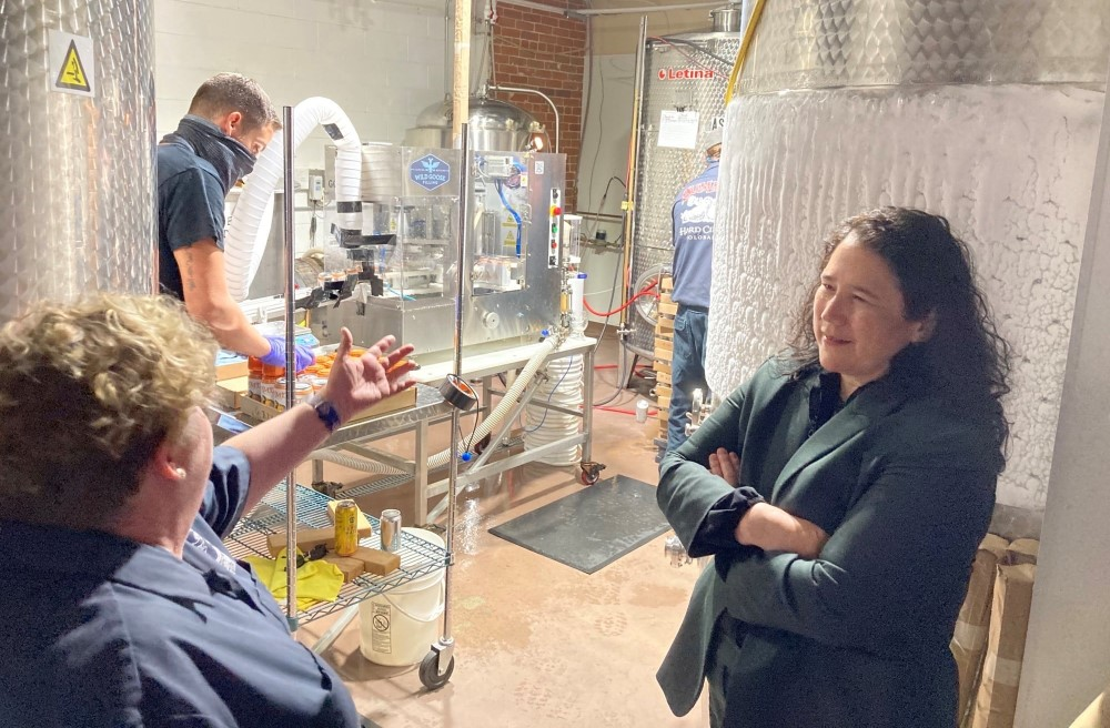 Isabella Guzman talks to a small business owner