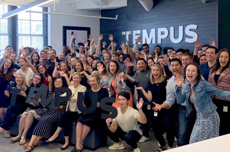 Tempus staff celebrate in their head office