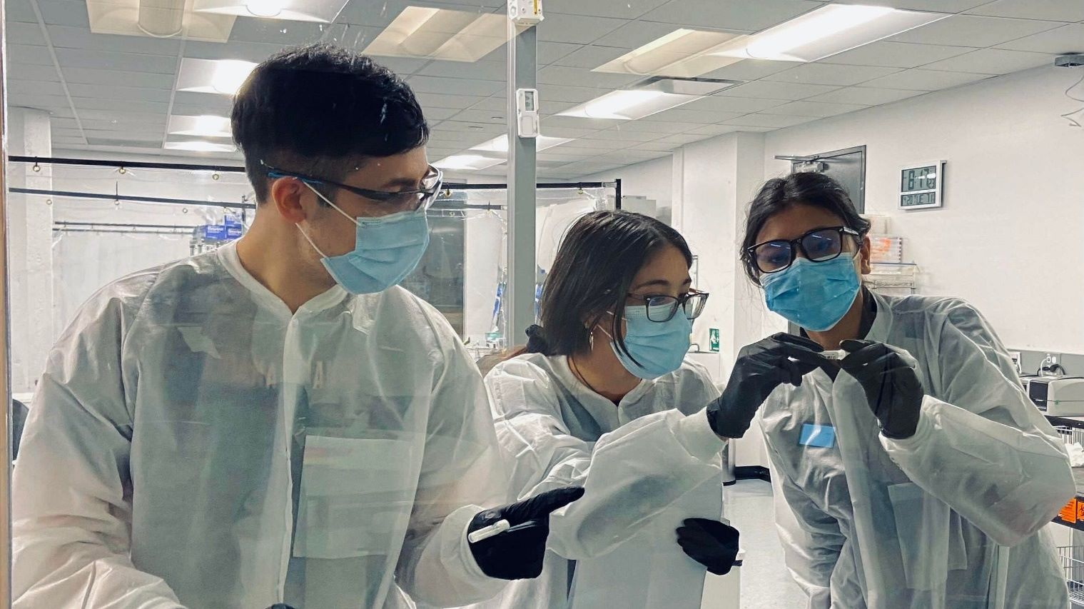Tempus staff in a lab and collecting sample