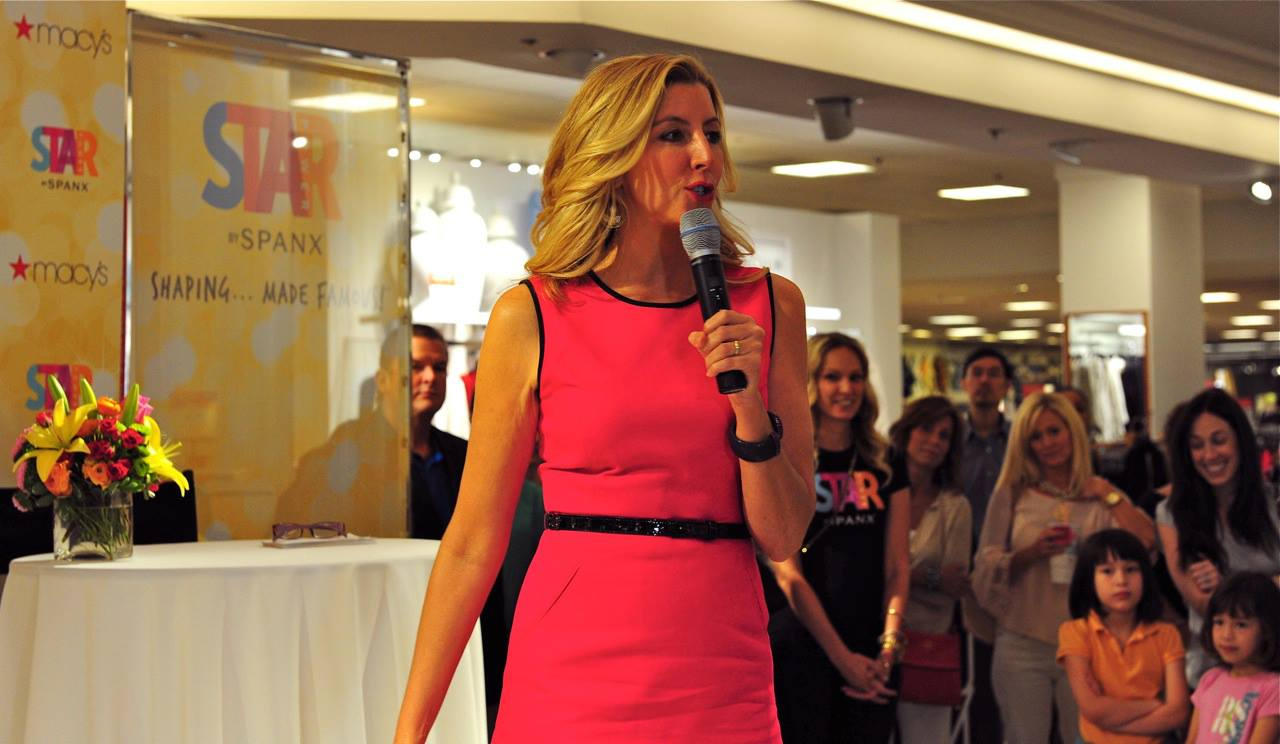 Sara Blakely talks in a department store in a mall